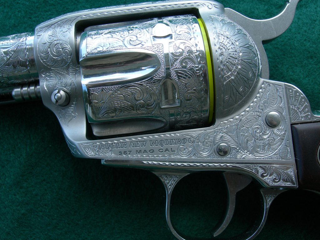 Example of engraving cuts left bright (non-inked) on a Ruger revolver.