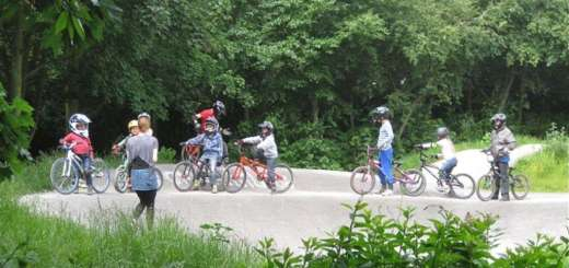 Kids cycling lesson in woods