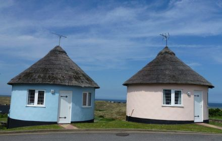 Two round holiday cottages one blue one pink
