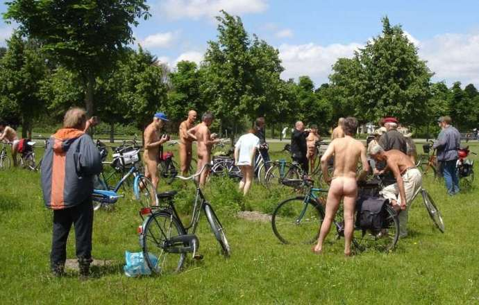 cyclists in park, many naked