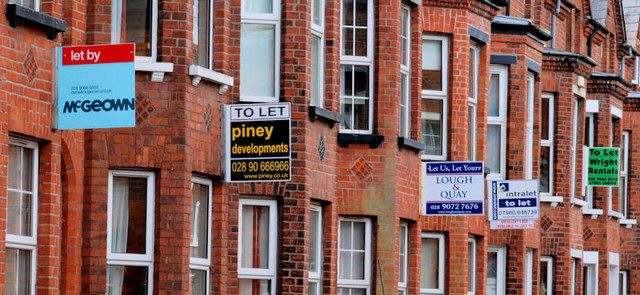 Row of houses with to let signs attached