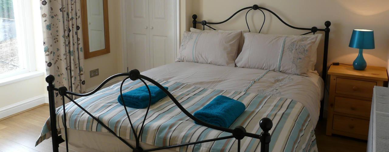 A bedroom at Carreglwyd Farmhouse holiday home, Port Eynon, Gower