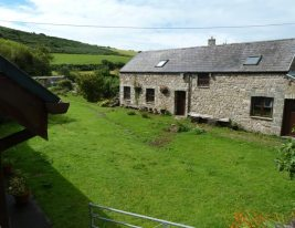 Delvid Stables holiday cottage and courtyard at Llangennith, Gower
