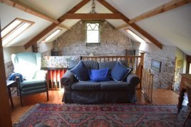 Upstairs sitting room at Delvid Stables holiday home, Llangennith, Gower