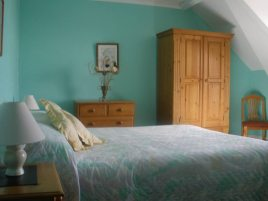 A double bedroom at Hollies self-catering cottage, Horton, Gower Peninsula