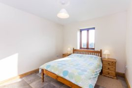 The master bedroom at The Tractor House holiday cottage, Llethryd, Gower Peninsula