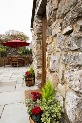 The patio area at The Bower Cottage self-catering holiday cottage, Port Eynon, Gower