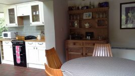 The kitchen and dining area Brook Cottage holiday home, Reynoldston, Gower
