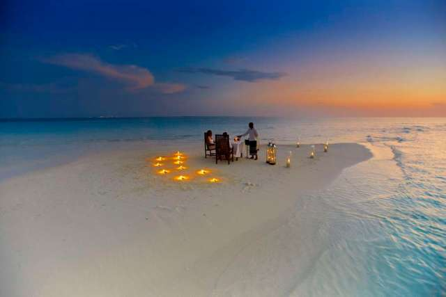 Baros offers a a private dinner for two prepared and served by your own private chef on a small sandbank in the middle of the crystal blue sea at sunset. Photo courtesy Baros.