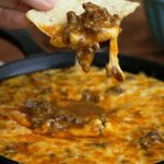 This Beef Enchilada Dip is a super easy and delicious appetizer. Perfect for game day parties or get-togethers.