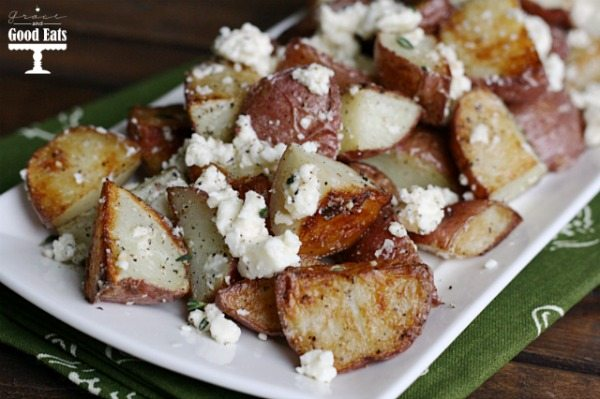 Feta Roasted New Potatoes- baby red potatoes tossed with feta and fresh thyme. Such an easy, but impressive side dish!