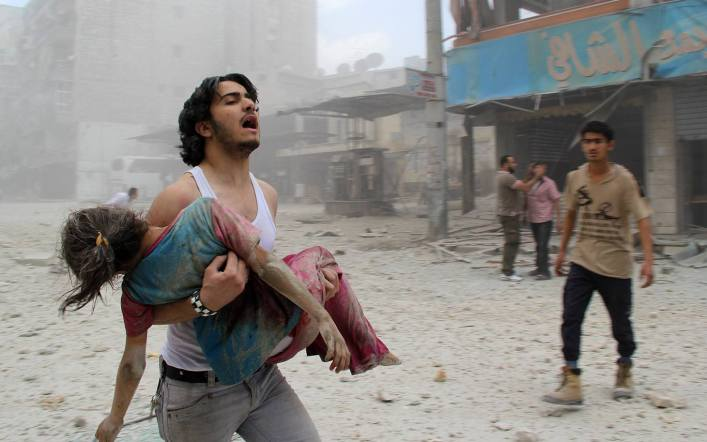 Dad carrying daughter. Bombing in Syria