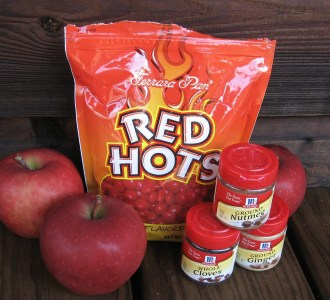 Learn how to make red hot cinnamon apples with canning instructions included!
