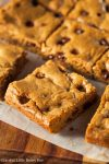 These Amish Chocolate Chip Cookie Bars are super easy to make and even easier to eat. Simply bake, slice and serve them for a fun chocolate treat!