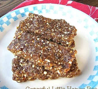 Homemade Energy Bars stacked on a white plate.