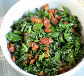 Finished Warm Kale and Bacon Salad in a large white bowl.