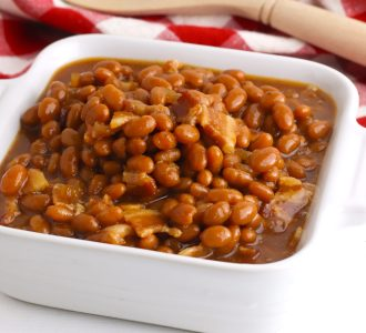 Brown Sugar Baked Beans in a white square baking dish.