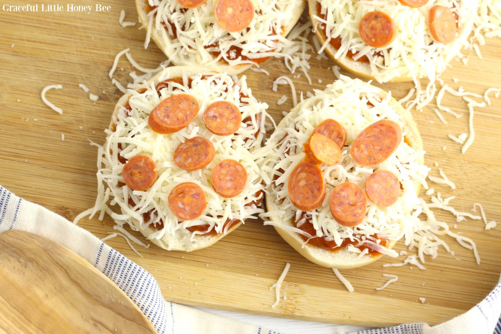 Bagels topped with sauce, cheese and pepperoni, before going into the air fryer.