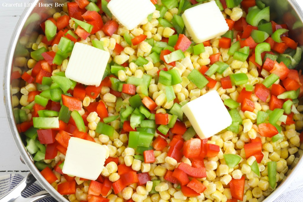 All ingredients for Fiesta Corn in a skillet before mixing and cooking.