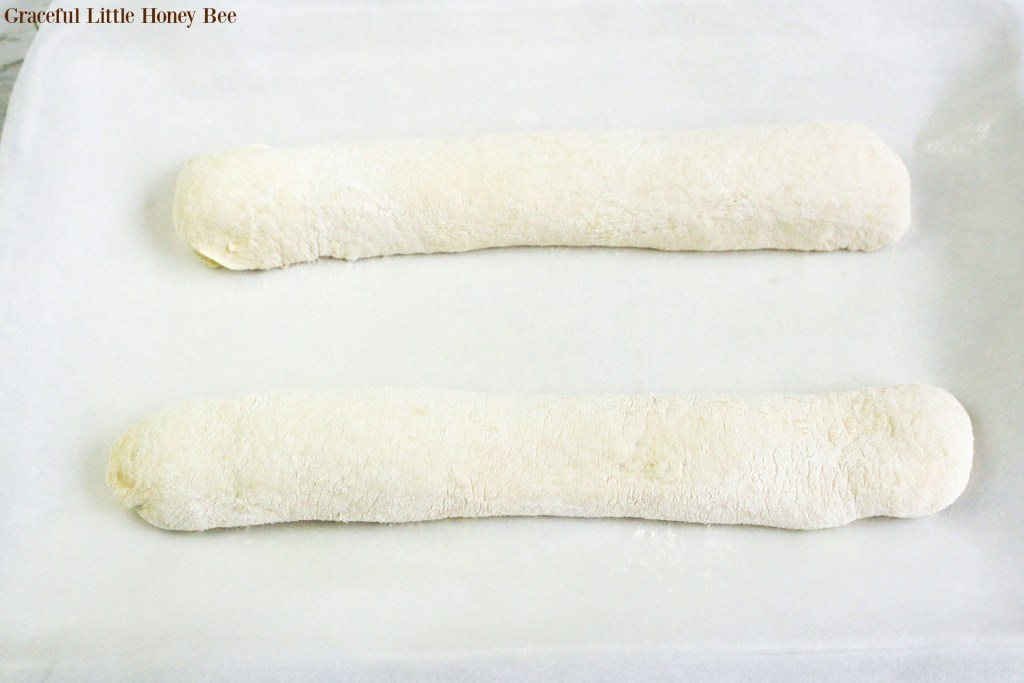 Dough shaped into two long ropes.