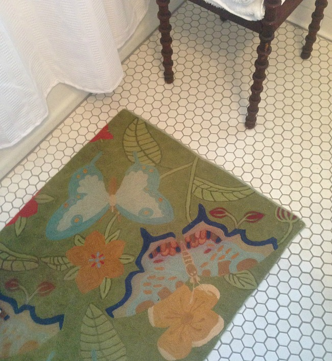 quirky bathroom rug adds personality
