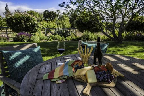 Enjoy your complimentary bottle of local wine on your private patio