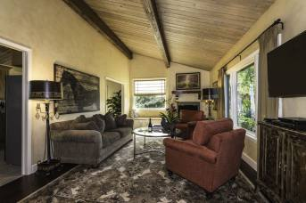 Tastefully decorated living area with flat screen TV, many current DVDs and a gas fireplace