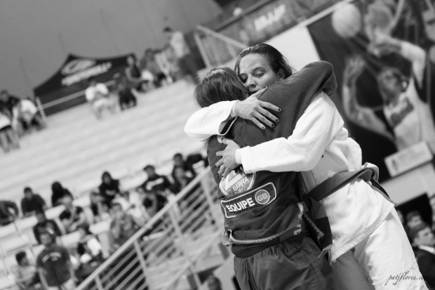 Kelly Nakagawa-Oliveira from Gracie Barra Chino embraces her opponent after a grueling match
