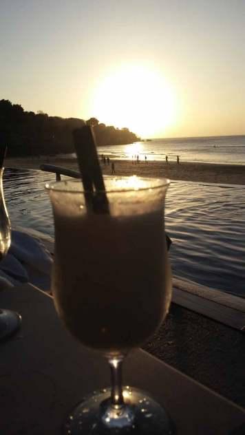 enjoying-sunset-at-Sundara-beach-club-jimbaran