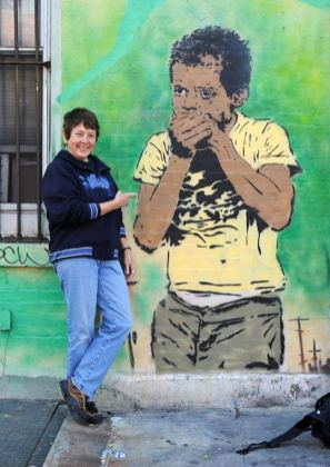 Martha Cooper with fellow Baltimore artist Chris Stain wall piece 2009.