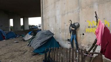 banksy-calais-france-steve-jobs-refugee-camp