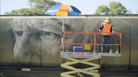 Guido Van Helten, Street Art Freight Carriages, Manildra, Australia 2016. Photo Credit @followthewanderers @selinamiles @bydrewmac @guidovanhelten