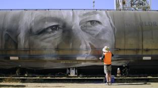 Guido Van Helten, Street Art Freight Carriages, Manildra, Australia 2016. Photo Credit @followthewanderers @selinamiles @bydrewmac @guidovanhelten