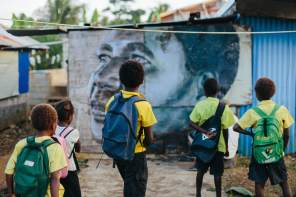 The-Wanderers-episode-Street-Artist -RONE_Local kids from the equip village admire RONE's portrait of local woman ELIZABETH MAS_credit Callie Marshall_I5A1954