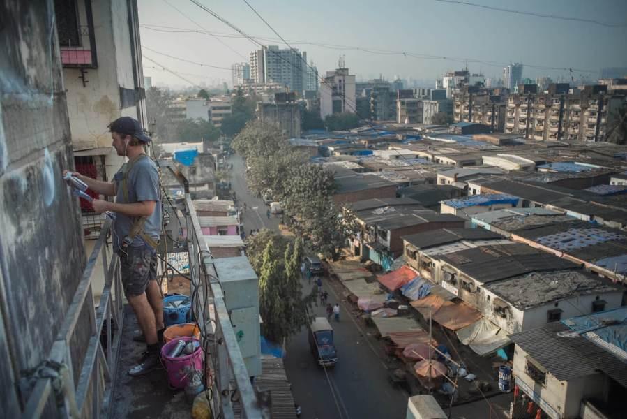 Guido Van Helten, Mahim (E) Art District, St+art Urban Art Festival, Mumbai 2017. Photo Credit Akshat Nauriyal