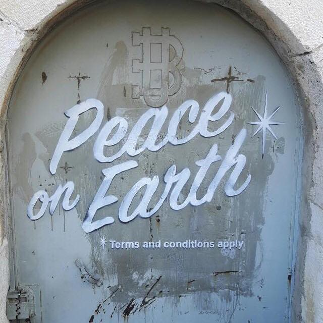 banksy-walled-off-hotel-christmas-message-peace-on-earth-separation-wall-pc-alaa.