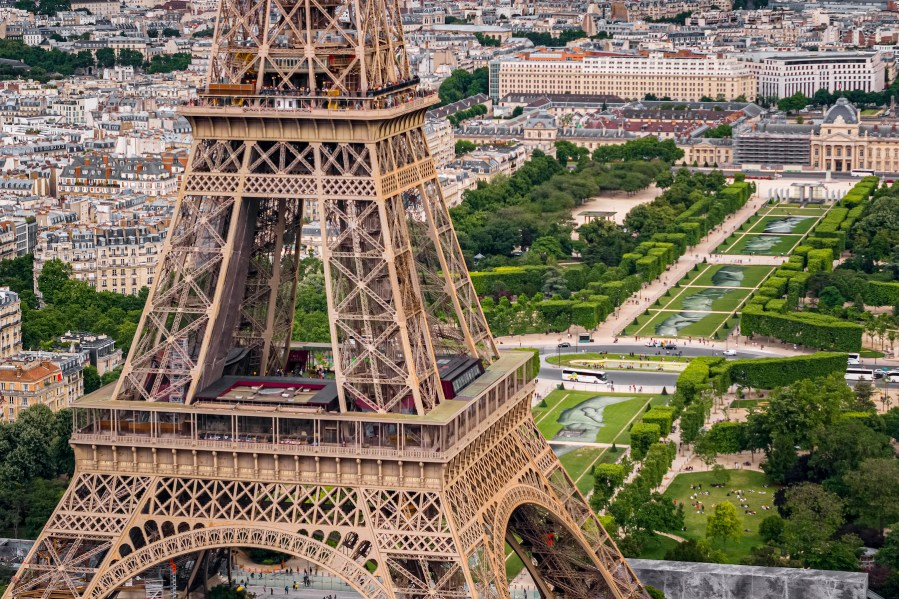 """A giant biodegradable landart painting by French-Swiss artist Saype is pictured on Tuesday June 11, 2019 on the Champ de Mars in front of the iconic Eiffel Tower in Paris, France. With an overall area of 15'000 square meters, the 600 meters long and 25 meters wide painting (likely one of the largest of its kind) was created using biodegradable pigments made out of charcoal, chalk, water and milk proteins. This art piece launches the worldwide project """"Beyond Walls"""" aiming at creating the longest symbolic human chain around the world promoting values such as togetherness, kindness and openness to the world. (VFLPIX.COM /Valentin Flauraud)"""