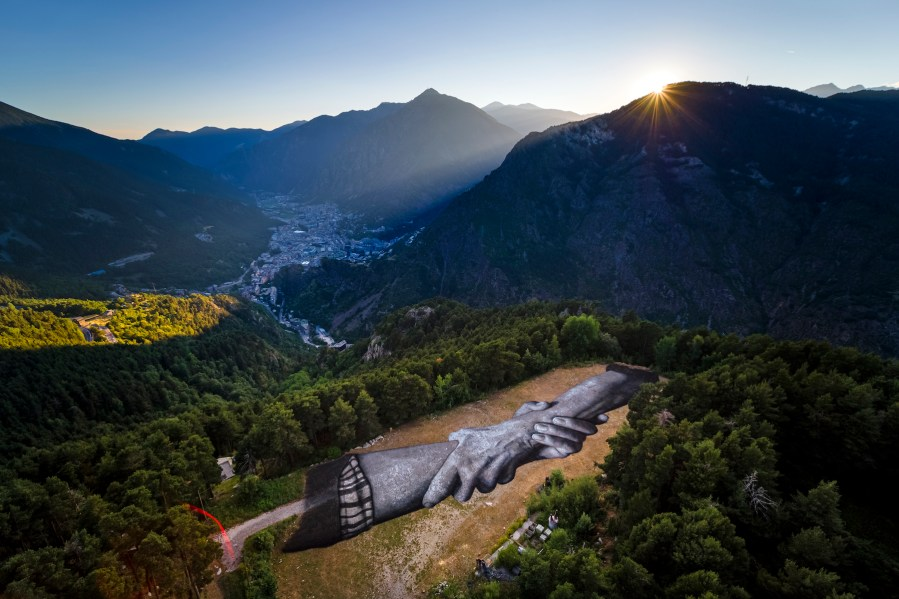 "A giant biodegradable landart painting by French-Swiss artist Saype is pictured between July 15 and July 16, 2019 at Engolasters in Andorra. With an overall area of 5'000 square meters, the 130 meters long and 38 meters wide painting was created using biodegradable pigments made out of charcoal, chalk, water and milk proteins. This art piece is the second step of the worldwide ""Beyond Walls Project"" aiming at creating the longest symbolic human chain around the world promoting values such as togetherness, kindness and openness to the world. (VFLPIX.COM /Valentin Flauraud)"