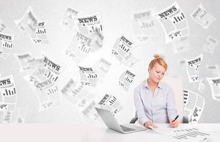 Woman surrounded by headlines