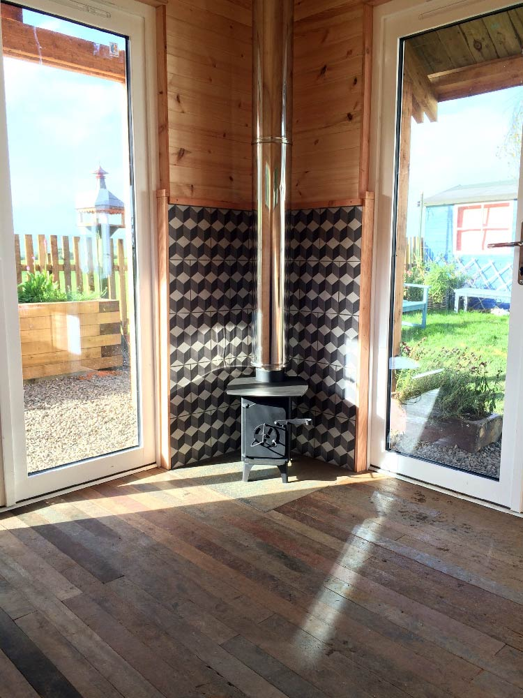 Larch Studio. Double glazed and wool insulated, with a wood burner and Cedar shingle roof.