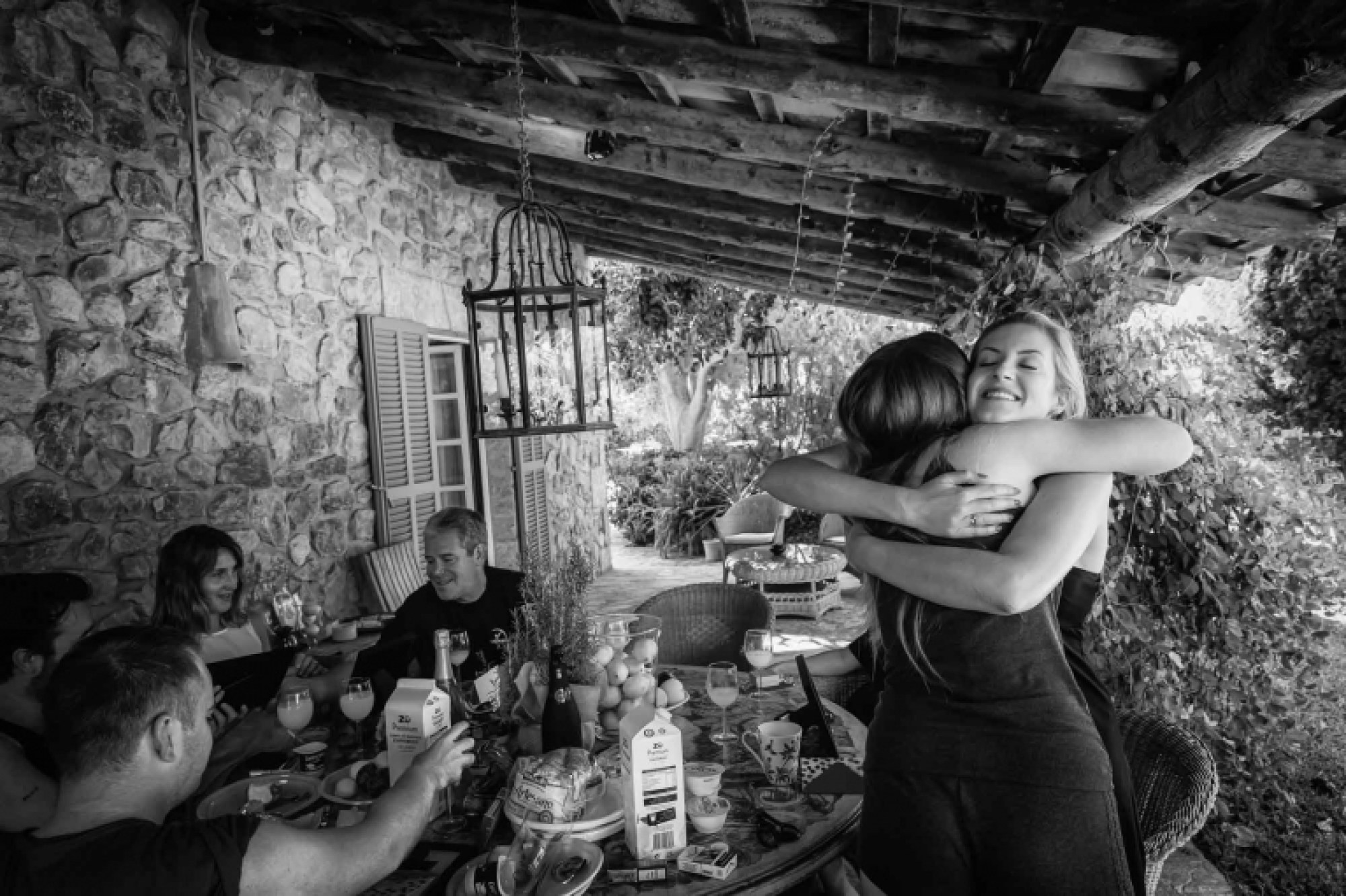 Cathy gives one of her bridesmaids a big hug before her Mallorca finca wedding