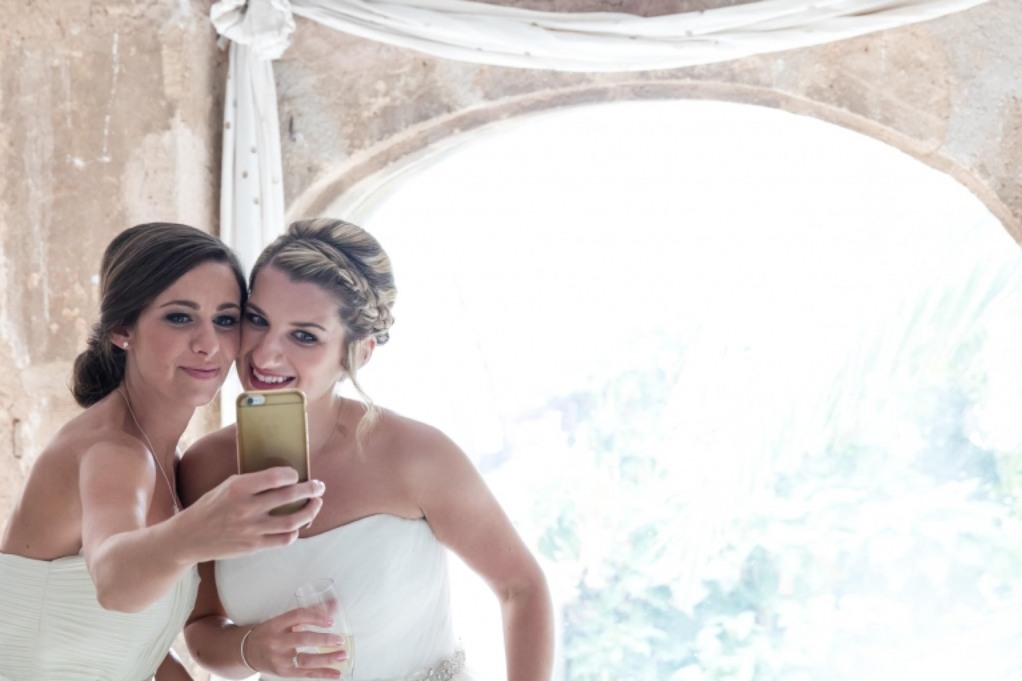 The bride and bridesmaid share a selfie at Hotel Can Vedera in Mallorca