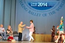 Yuri Grigorovich presenting Julian with his medal at Sochi