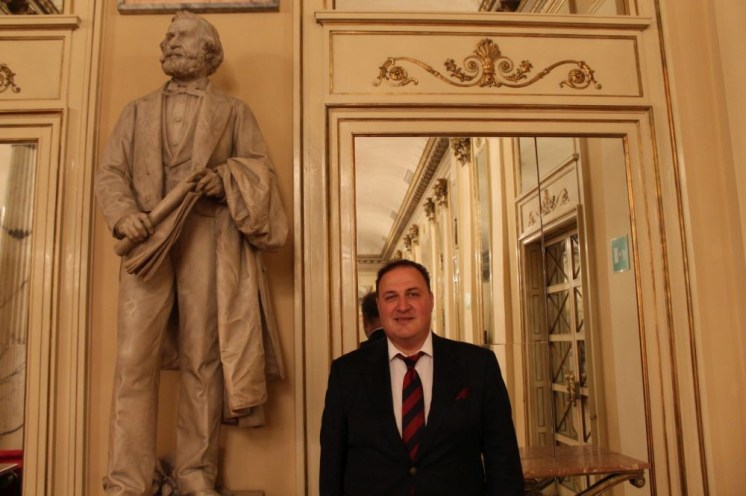 George Gagnidze with the statue of Giuseppe Verdi at La Scala 2018