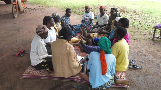 0770-05 - Makerere University - Women attending a GSP group session in Paibona village Gulu district