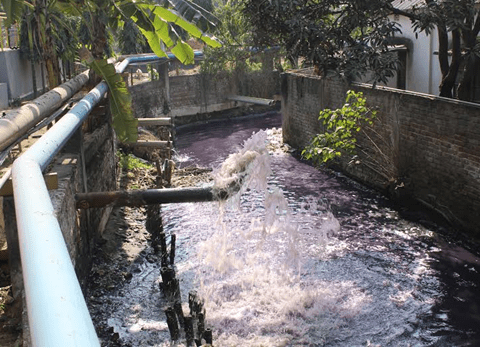 The saying is you can tell what colour is fashionable in the west by looking at the color of the river in the east. This river is purple from the dyes and chemicals being released by all the factories surrounding Gazipur.