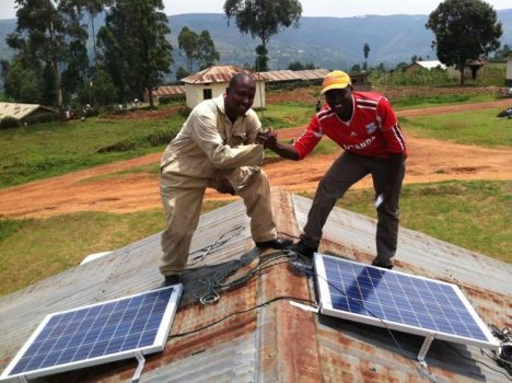 Installing solar panels on the roofs of health facilities in the mountainous southwestern region of Uganda. Photo courtesy of We Care Solar®
