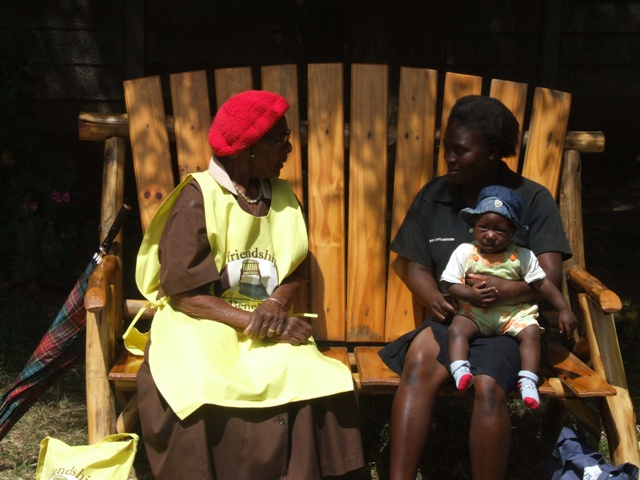 In Zimbabwe, a trained health worker counsels a young mother on the Friendship Bench. Brief interventions are proving to be helpful dealing with depressed and anxious patients.
