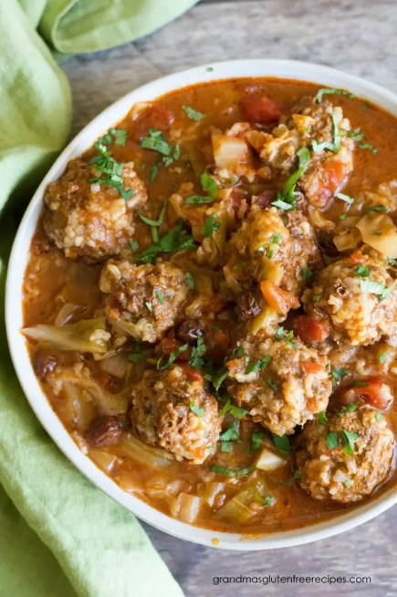 top view of a bowl of unrolled cabbage and meatballs