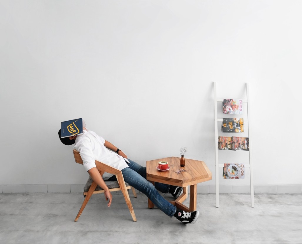 man sitting lazy. work hard culture